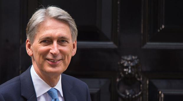 The new Chancellor faced calls to publish an analysis of how measures in budgets hit people across the earnings range after George Osborne abandoned the practice