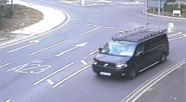 A CCTV image of a black modified VW Transporter leaving the Redstone Hill, Redhill, area in Surrey (Surrey Police/PA)