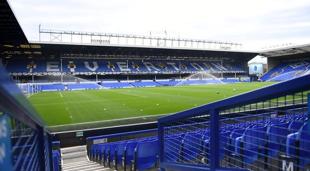 An Everton fan died after collapsing at Goodison Park