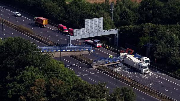 The scene on the M20 motorway after the lorry hit a motorway footbridge, causing it to collapse