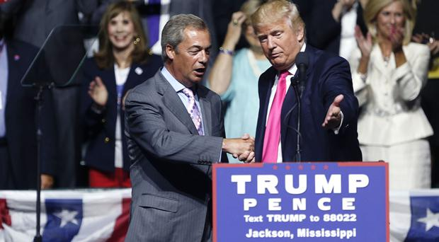 Republican presidential candidate Donald Trump, right, welcomes Nigel Farage at the rally in Jackson, Mississippi (AP)