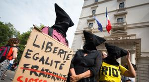 There have been protests against the ban in the UK as well as France