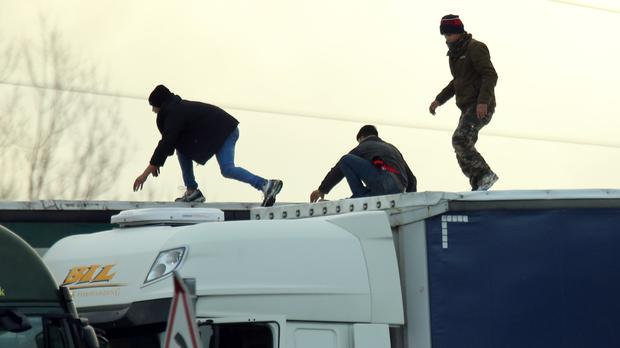 Migrants on the roof of a lorry along the A16 in Calais