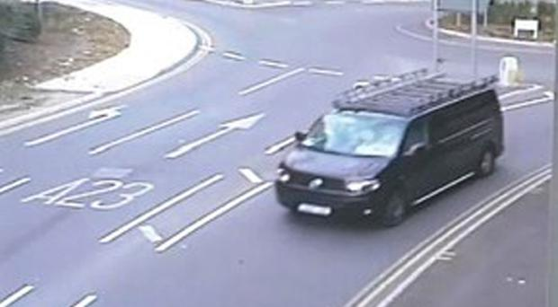 CCTV image issued by Surrey Police of a black modified VW Transporter in Redhill as officers investigate reports of a possible abduction of a young boy