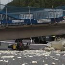 The motorcycle lying on the ground under a collapsed bridge on the M20 in Kent