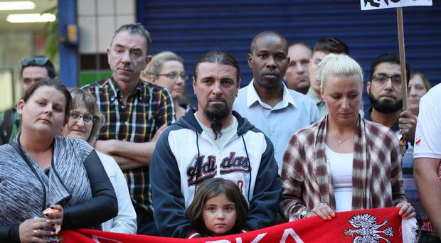 People attend a vigil in Harlow to pay tribute to Arkadiusz Jozwik