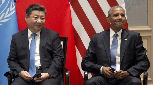 US president Barack Obama, right, and Chinese president Xi Jinping during a climate event at the Ruyi Hall at West Lake State House in Hangzhou in eastern China (AP)