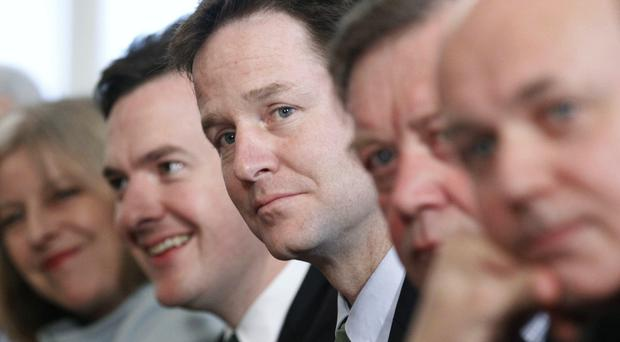 Nick Clegg, centre, says he was urged to let George Osborne, left, have use of a stately home usually the preserve of the deputy prime minister