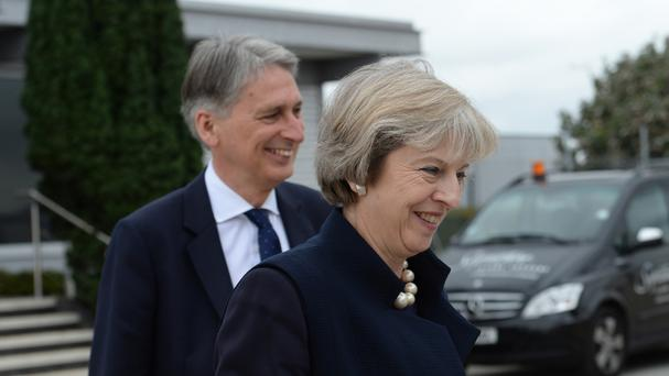 Prime Minister Theresa May and Chancellor of the Exchequer Philip Hammond at Heathrow Airport before she boarded a plane for the G20 Summit in Hangzhou