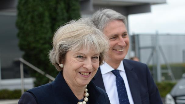 Prime Minister Theresa May, pictured with Chancellor Philip Hammond, has dismissed the idea of an Australian-style points-based immigration policy