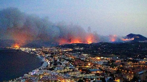 A wildfire raging in Javea near Benidorm, Spain, that has forced the evacuation of around 2,000 people.