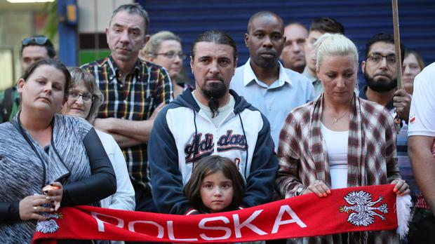 People attend a vigil in Harlow after the death of a Polish man in a possible hate crime