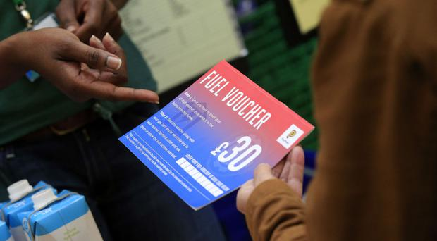A fuel voucher being given out at a foodbank