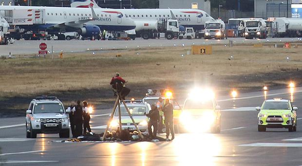 Black Lives Matter UK of protesters after they stormed the runway at London City Airport. (Picture: Black Lives Matter)