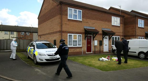 The scene outside a house in Spalding, Lincolnshire, where Elizabeth Edwards and her 13-year-old daughter Katie were found dead