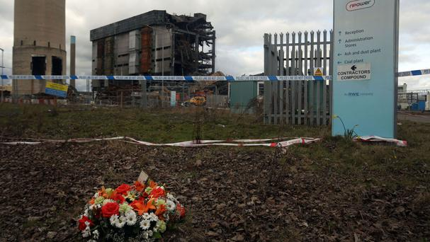 Flowers at the scene at Didcot power station in Oxfordshire