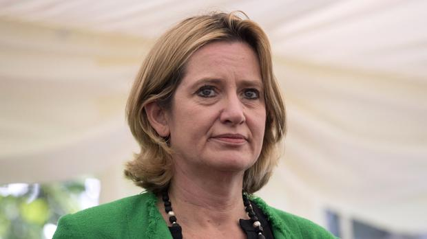 Amber Rudd said the UK was considering a work permit system