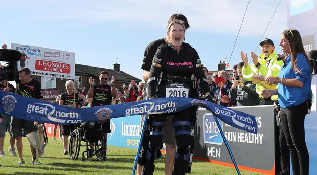 Claire Lomas crosses the finish line in her robotic suit during the Great North Run