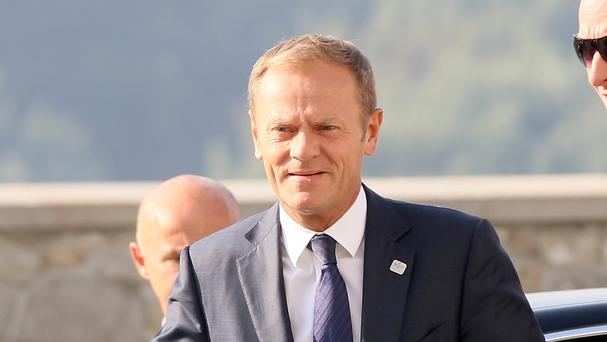 Donald Tusk arrives for the EU summit at Bratislava Castle - he said that Theresa May hopes to trigger Article 50 next January or February (AP)
