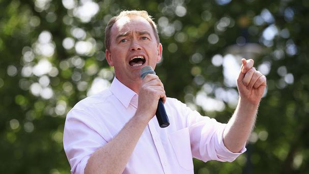 Tim Farron will tell Lib Dem delegates that Nigel Farage remains the real focus of power in Ukip