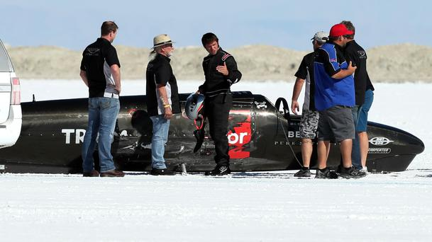 Guy Martin, centre, after the Triumph Infor Rocket Streamliner he was riding tipped over