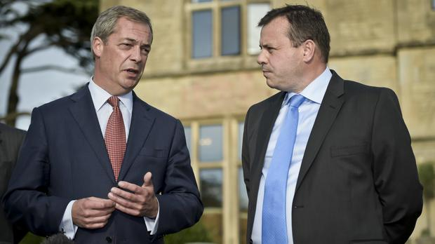Arron Banks, right, said he went for a skinny dip with Nigel Farage