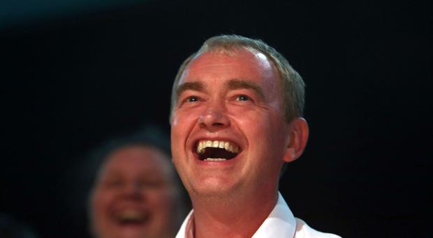 Liberal Democrats leader Tim Farron laughs at a speakers impression during a Rally at the party's Autumn Conference in Brighton, Sussex.