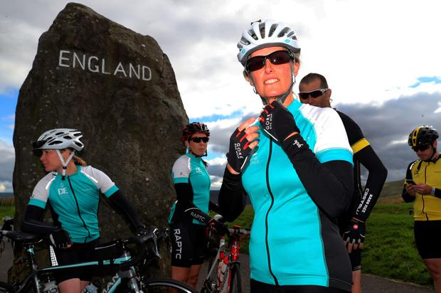 The Countess of Wessex (centre) crosses the border between Scotland and England at Carter Bar with other riders, as she takes part in the 450-mile cycling challenge