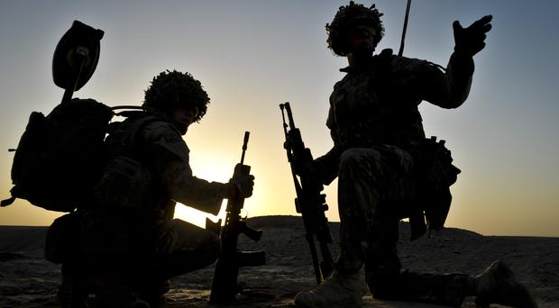 Military action to defeat Islamic State needs to be backed by diplomatic and political efforts, MPs say