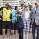 The Earl of Wessex congratulates the Countess of Wessex, third left, with their children at the end of a 450-mile cycling challenge