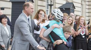 The Earl of Wessex congratulates the Countess of Wessex with their children Lady Louise Windsor and James, Viscount Severn, as she arrives in London at the end of a 450-mile cycling challenge from the Palace of Holyroodhouse in Edinburgh to Buckingham Palace in London, for her 'DofE Diamond Challenge' which marks the 60th anniversary of The Duke of Edinburgh's Award Scheme.