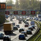Traffic uses the hard shoulder of the M42 near Solihull during busy times