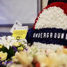 Flowers left at Russell Square tube station, London, as Britain remembered the July 7 bombings