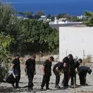 South Yorkshire Police officers search an olive grove on the Greek island of Kos, close to where toddler Ben Needham went missing 25 years ago
