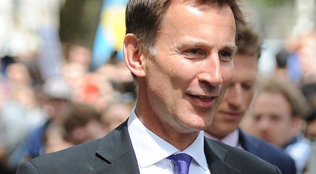 MPs said Health Secretary Jeremy Hunt must do something to stop hospitals discharging some patients at night