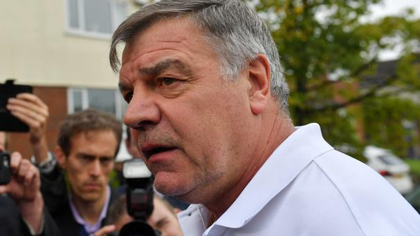 Sam Allardyce speaks outside his home in Bolton where the former England manager told reporters he had made