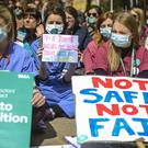 Junior doctors protest outside Bristol Royal Infirmary during strike action in April 2016