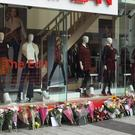 Floral tributes outside the Matalan store in Queen Street, Cardiff, following the deaths of Lee Simmons and Zoe Morgan