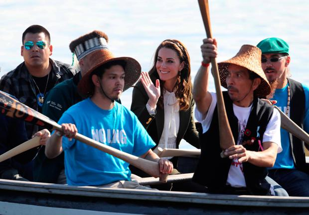 The Duchess of Cambridge waves as she makes her way by canoe to Haida Heritage Centre