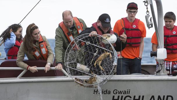 The royal couple watch as a crab trap is pulled up (The Canadian Press/AP)