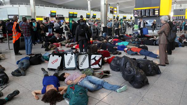 Campaigners stage a mass 'Die-In' in Terminal 2 at Heathrow Airport