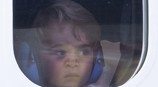 Prince George on board the seaplane at Victoria Harbour