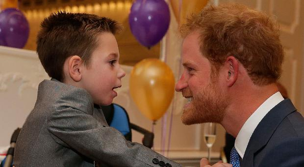 Prince Harry meets Inspirational Child award winner Ollie Carroll at the WellChild Awards in London yesterday
