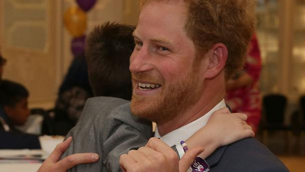 Prince Harry greets Inspirational Child Award Winner Ollie Carroll at the WellChild Awards in London