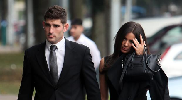 Ched Evans with partner Natasha Massey arrive at Cardiff Crown Court