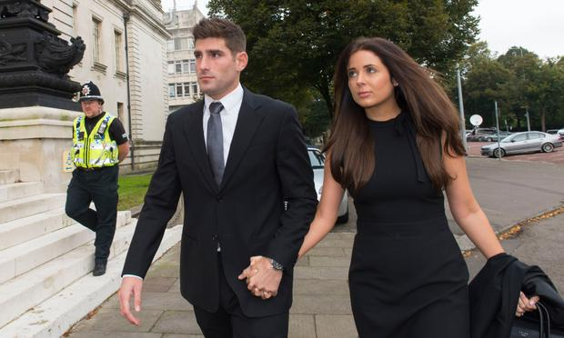 Football player Ched Evans arrives at Cardiff Crown Court with partner Natasha Massey yesterday