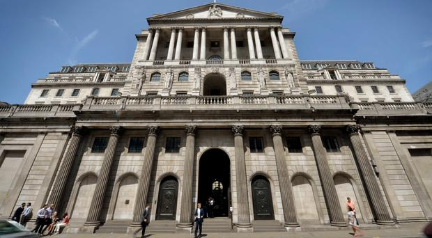 Theresa May's comments come after the Bank of England, pictured, cut interest rates to a new all-time low in August