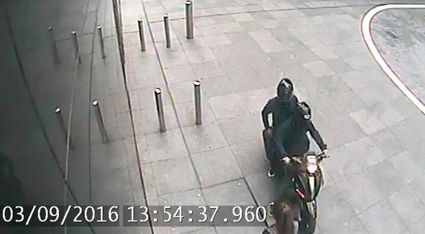 CCTV of Cavell Hutson and an unknown accomplice as they prepare to snatch a woman's phone. (Picture: Metropolitan Police)