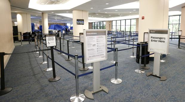 Departure lines at Palm Beach International Airport lie empty after flights were cancelled (AP)