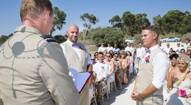 Air Vice Marshal Mike Wigston, Sergeant Alastair Smith and Aaron Weston during the first same-sex wedding on a British overseas base (Sgt Andrew Benson (RAF)/PA)